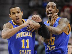 Morehead State's Terrance Hill (11) and Lamont Austin (10) celebrate during the Eagles' upset of fourth-seeded Louisville in Denver.