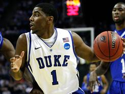 Kyrie Irving returned to the court for Duke and scored 14 points in 20 minutes of action to help the Blue Devils overwhelm Hampton in the second round of the NCAA tournament.
