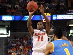 Erving Walker scored 21 points to lead Florida to a 73-65 win over UCLA and a spot in the Sweet 16.