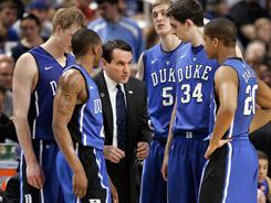 Duke coach Mike Krzyzewski is just two wins away from tying Bob Knight for the most wins among Division I coaches.