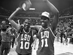 LSU players Derrick Taylor, left, and Anthony Wilson celebrate after their win over Kentucky in the 1986 Southeast Regional final in Atlanta.