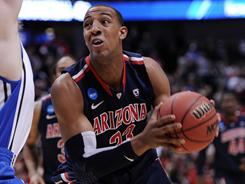 Derrick Williams and the Arizona Wildcats look to complete their Final Four quest when they face the UConn Huskies Saturday in Anaheim, Calif.
