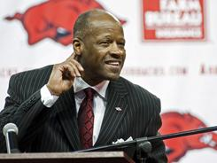 New Arkansas head coach Mike Anderson signals to the crowd to cheer during his introductory news conference in Fayetteville, Ark.