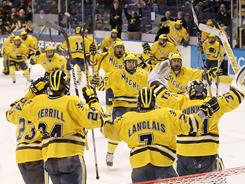 The Michigan Wolverines celebrate as time expires during their win over Colorado College that earned a spot in the Frozen Four.