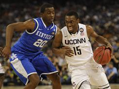 Connecticut's Kemba Walker drives on Kentucky's Doron Lamb during the Huskies' semifinal victory in Houston on Saturday.