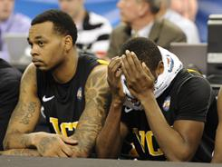 The VCU bench reacts during the final moments of their semifinal loss to Butler Saturday in Houston.