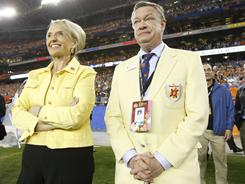 Former Fiesta Bowl CEO John Junker, right, stands with Arizona governor Jan Brewer on the sidelines during the 2010 Fiesta Bowl.