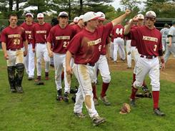 The Portsmouth baseball players celebrate last week after winning their 76th consecutive game. On Thursday, Portsmouth beat Pelham for its 79th straight win.
