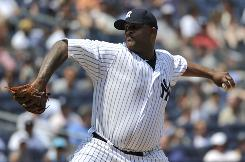 CC Sabathia of the Yankees threw eight shutout innings against the Mets.