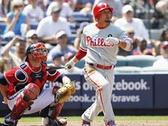 Shane Victorino hits a sixth-inning solo homer off the Breaves' Derek Lowe.