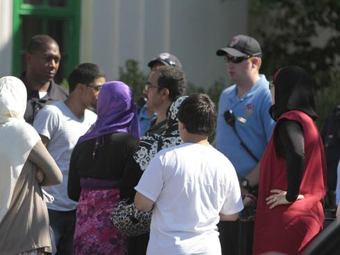Picture of law enforcement and Muslim park goers