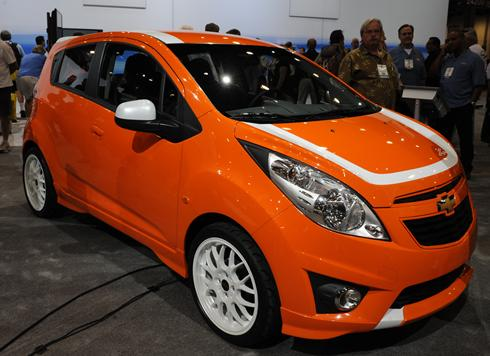 a bright-orange and white-striped Chevrolet Spark showed off how the