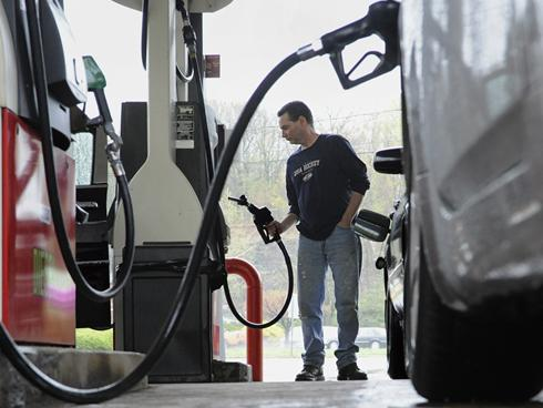 John Magel pumps gas at a station in Wethersfield, Conn. <i>By Jessica Hill, AP</i>