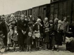 Jewish women and children deported from Hungary, separated from the men, line up for selection on the selection platform at Auschwitz camp in  Birkenau, Poland in May 1944. Israel's Holocaust memorial museum, The Yad Vashem, has reached an agreement with Poland to obtain access to Holocaust records that may identify some of the millions who died in Nazi camps in Poland