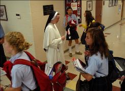 Sister Julia Marie O.P. walks past students to her classroom before teaching a chemistry lesson to high school girls at St. Cecilia Academy on Tuesday, Sept. 14, 2010 in Nashville, Tenn. The Dominican Sisters of St. Cecilia has 27 postulants entering the convent this fall, likely the largest group of new nuns in training in the U.S., according to religious scholars.