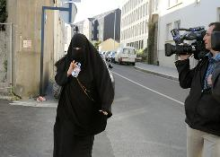 The French senate has passed a ban on full veils such as this one, shown in August when a woman arrived at the police station in Nantes. The ban may still be challenged on constitutional grounds.