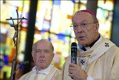 The head of the Belgian Catholic church, Archbishop Andre-Joseph Leonard (R), Hand-picked by Pope Benedict XVI last year, has become a divisive factor to the Catholic mainstream and close associates. However there are now calls for his resignation