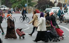 Muslim women wearing headscarves walk in the immigrant-heavy district of Kreuzberg on September 21, 2010 in Berlin, Germany. German politicians are debating past and future govenment policies to encourage the integration of immigrants into German society.
