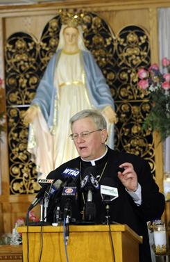 Bishop of the Diocese of Green Bay Rev. David Ricken fields questions about the official pronouncement to officially approve the Marian apparitions of 1859 Wednesday, Dec. 8, 2010 at the Shrine of Our Lady of Good Help in Champion, Wis.