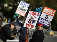 Westboro Baptist Church, shown here in October demonstrating outside the U.S.Supreme Court, plans to picket Elizabeth Edwards' funeral. The high court is considering whether Westboro, which pickets U.S. soldiers' funerals to claim that God is punishing Americans because of society's acceptance of homosexuality, is testing the limits of the First Amendment right to free speech.