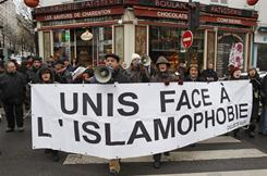 Demonstrators hold a banner which reads, 'unity against Islamophobia', to protest against the conference on the Islamization of France and Europe, held in Paris on Saturday,