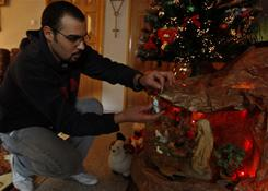 Palestinian Christian Samer Najjar decorates a Nativity scene at his house in Gaza City, Thursday, Dec. 23, 2010. More than 500 members of the Gaza Strip's tiny Christian community left the blockaded territory on Thursday to participate in Christmas celebrations in Jesus' traditional birthplace of Bethlehem. About 3,500 Christians live in Gaza among 1.5 million Muslims.