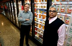 Jack Acree, executive vice president with American Halal Co., Inc., left, and Adnan Durrani, Chief Halal Officer with American Halal Co., stand near their products in a freezer case at a Whole Foods store in Darien, Conn. The company helped Whole Foods develop its first nationally distributed halal (Islamically permitted) food product called Saffron Road entrees that the food stores started selling in August.