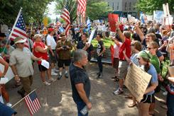 This July 14, 2010 photo shows protesters, left, and counter protesters, right, shouting at each other during a demonstration about a planned mosque and Islamic community center in Murfreesboro, Tenn. Battling the mosque in the courts has cost Tennessee taxpayers $75,000 so far.