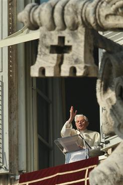 """Pope Benedict XVI blesses the faithful from the window of his apartment during his Sunday Angelus prayer in St. Peter's square at the Vatican on January 2, 2011. He said the bomb blast that killed 21 people leavng a church after Mass in Egypt """"offends God and all of humanity."""" He urged world leaders to defend Christians against abuse and intolerance."""