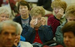 Parishioner Joan Foley, center, of Dedham, Mass. wipes tears at Saint Susanna Parish in Dedham, Mass., Tuesday, May 25, 2004, after she found her church will be closed when the Boston Archdiocese closed and consolidated scores of parishes in 2004. But several held vigils lasting six years to keep doors open. Today, Pope Benedict XVI denied their appeals.
