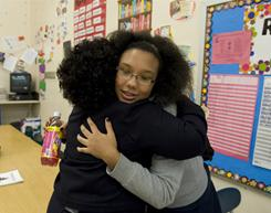 Tayshauna Lester, a 7th grader at Allegheny Traditional Academy in Pittsburgh, gets a hug from Tamara Davis following a mentoring session after school.