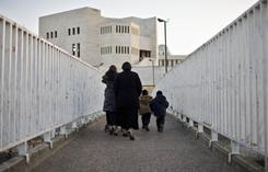"Demographers now estimate about a third of last year's Jewish babies were born into the ultra-Orthodox community, like this family shown crossing a bridge in Jerusalem. This sub-group within Jewish Orthodoxy -- known in Hebrew as ""Haredim,"" or ""those who tremble"" before God -- has a birth rate far higher than that of other Israeli Jews and may become numerous and influential."