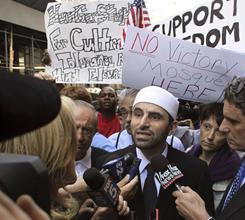 Shaykh Abdullah Adhami, shown here in August surrounded by reporters and demonstrators as he arrives at the proposed Lower Manhattan site for an Islamic cultural center in New York, will become the new the public face of the Park 51project.