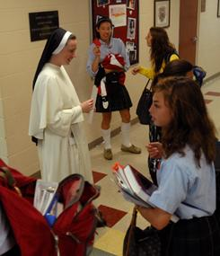 Sister Julia Marie O.P. walks past students to her Nashville classroom last fall. A new study finds parents are often the most discouraging voices when their daughters consider becoming a nun or sister.