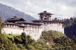 Buddhism is the religion of Bhutan (shown in this 2002 photo of the 17th century fort that houses religious centers) but its peaceful message is contradicted in a new study that shows most Bhutanese women think their husbands have the right to beat them. 