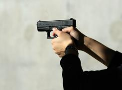 Do guns like this Glock 27 .40 caliber handgun, belong in church? Several states and pastors are wrestling with the question.