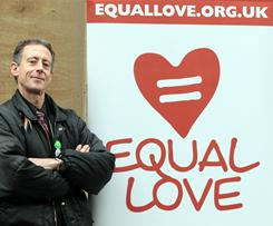 Gay rights campaigner Peter Tatchell poses with a sign for the Equal Love campaign.
