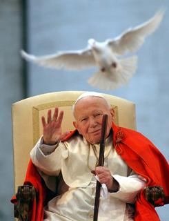 When Pope John Paul II, shown here in 2003 with a white dove of peace, is beatified by the Catholic Church on May 1, the Mass at St. Peter's Square won't require tickets or invitations.