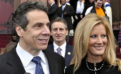 A Catholic legal expert says N.Y. Gov. Andrew Cuomo (shown here on left leaving church with his live-in girlfriend Sandra Lee) should not receive Holy Communion.