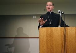 Cardinal Roger Mahony, shown here in 2007 announcing a $660 million settlement with clergy sex abuse victims, retires this week as archbishop of Los Angeles.