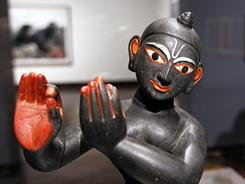 "A statue titled ""Krishna Fluting"" is displayed at the exhibit ""Vishnu: Hinduism's Blue-Skinned Savior"" at the Frist Center for the Visual Arts, in Nashville, Tenn. The exhibit aims to introduce the artwork of Hinduism to a largely uninitiated audience."