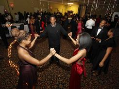 The fast-growing Seventh-day Adventist religion teaches no pre-marital sex. In this January 2010 photo Huston Fletcher, 17, center, dances with Phyllisia Reed, 17, left, and Jasmine Ward, 17, right, during a Purity Ball at a church in Nashville, Tenn.