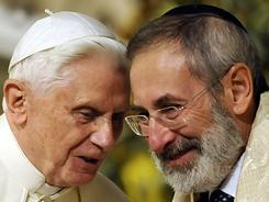 Pope Benedict XVI's visit to a memorial to civilians massacred by Nazis in World War II is not his first effort to reach out to Rome's Jews. Here he chats with chief Rabbi Riccardo Di Segni in Rome's main Synagogue on January 17, 2010.