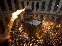 Every year at the Holy Week  Holy Fire ceremony in the Church of the Holy Sepulcher in Jerusalem, religious groups contest for space -- and block the only fire exit.