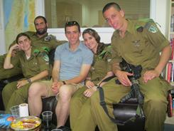 Front row, left to right, Israeli soldiers Roxanne Fogelman, Michael Eliav (in shorts), Ruth Stukalov, and Jonny Handler gather at the the Lone Soldier Center in Jerusalem, which provides a home away from home for ex-pats serving in the Israeli Defense Forces.