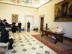 Pope Benedict XVI, right, prepares to answer questions on Italian state TV, on Good Friday. He told a Japanise child, frightened by disasters in her homeland, that suffering is not in vain.