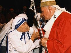 "Both Pope John Paul II and Mother Teresa of Calcutta, shown here at the Vatican in 1997, are on the ""fast track"" to sainthood -- the Vatican sped up consideration of their ""cause."""