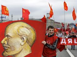 A Communist party supporter holds a portrait of the Soviet founder Vladimir Lenin during a rally to mark May Day  in Moscow, A new exhibit traces what may be Lenin's Jewish roots.