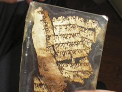 Software developed by Israeli scholars details what researchers believe to be multiple writers behind the Bible, using an algorithm to examine texts drawn from ancient manuscripts such as this parchment believed to be part of the most authoritative manuscript of the Hebrew Bible, the Aleppo Codex.