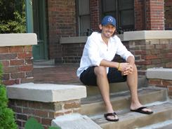 CommunityNEXT Director Jordan Wolfe sits outside  his apartment north of downtown Detroit. Wolfe is coordinating a rent subsidy program aimed at luring young, Jewish professionals into downtown or Midtown Detroit.